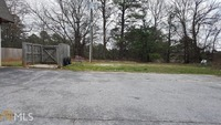 Home for sale: 2141 S.E. Flat Shoals Rd., Conyers, GA 30013