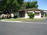 Home for sale: 2400 Midvalley Avenue, Visalia, CA 93277