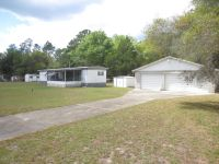 Home for sale: 8636 N.E. 153rd Avenue, Silver Springs, FL 34488